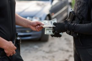 Former Cop Pleads Guilty to Accepting $14K in Bribes in Pot Trafficking Case
